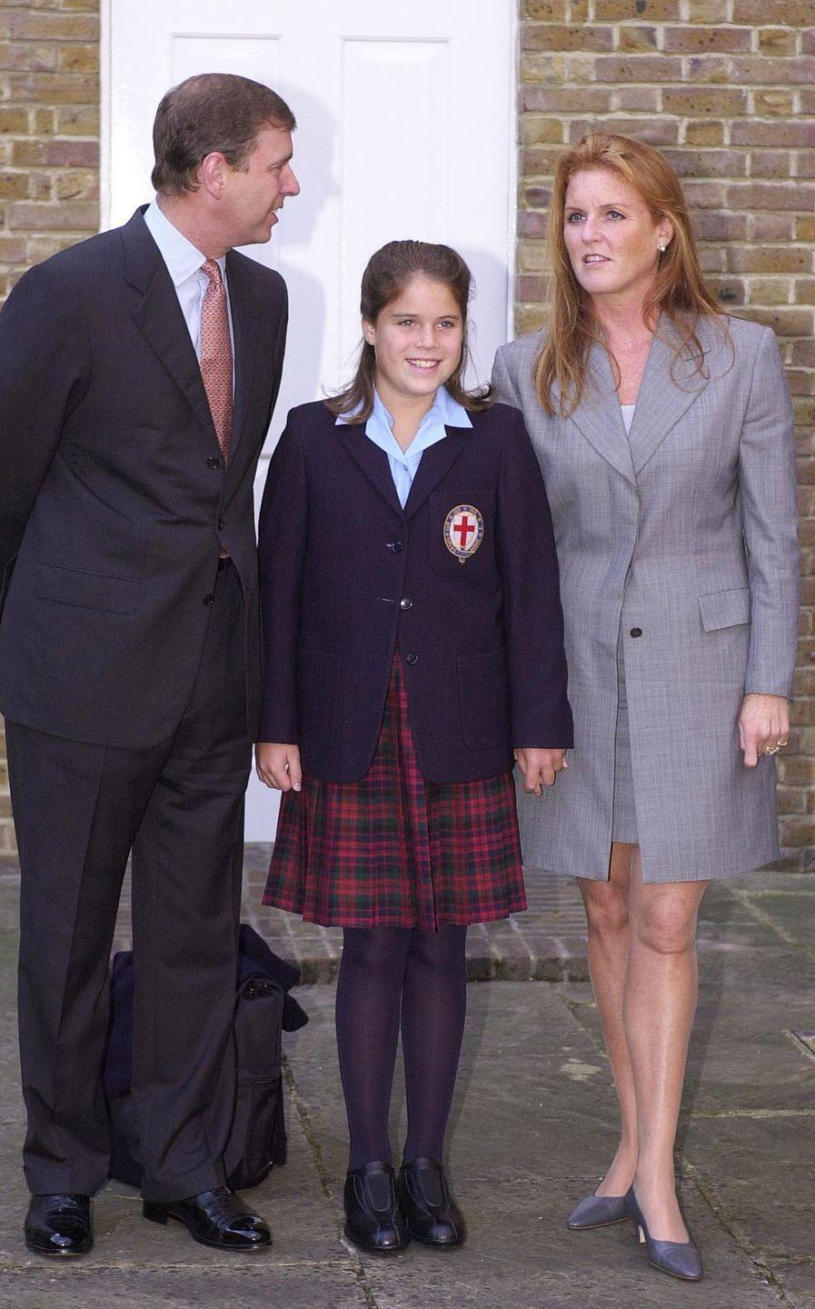 <p>11-year-old Princess Eugenie smiles with her parents on her first day at St. George's School, Windsor. </p>