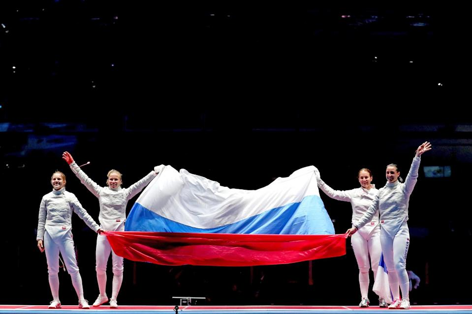 <p>Russia celebrates winning gold after the Women's Sabre Team gold medal match between Russia and Ukraine on Day 8 of the Rio 2016 Olympic Games at Carioca Arena 3 on August 13, 2016 in Rio de Janeiro, Brazil. (Photo by Tom Pennington/Getty Images) </p>