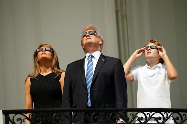 President Trump with first lady Melania Trump and their son, Barron, watch from the Truman Balcony at the White House. (Photo: Kevin Lamarque/Reuters)