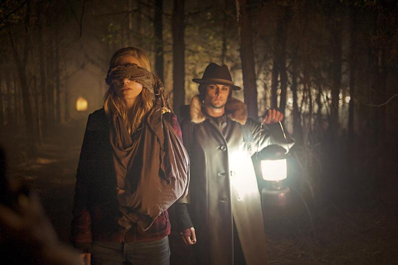 "This film publicity image released by Fox Searchlight Pictures shows Brit Marling, left, and Shiloh Fernandez in a scene from ""The East."" (AP Photo/Fox Searchlight Pictures, Myles Aronowitz)"