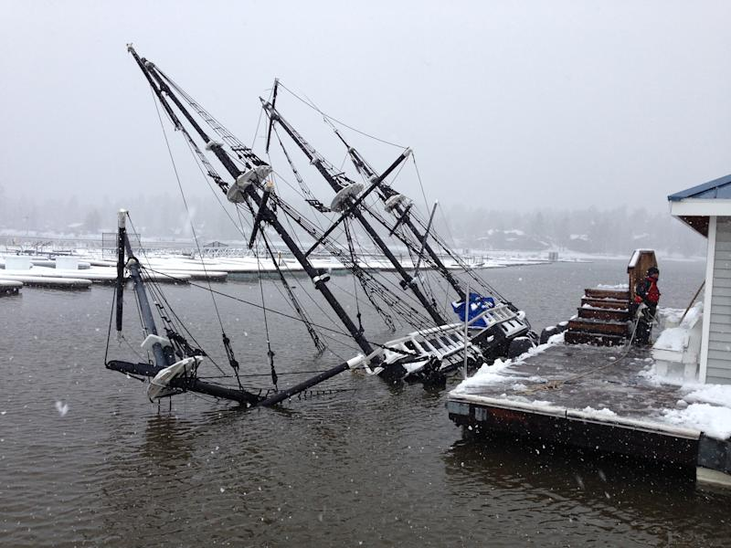 "This Saturday, March 1, 2014 photo provided by the Big Bear Visitors Bureau shows a 43-foot pirate ship tour boat partially submerged under water in Big Bear Lake, Calif. The 27-ton boat had been docked at Holloway Marina before sinking. The one-third scale 16th century Spanish galleon replica was a prop in the movie ""Time Bandits."" (AP Photo/Big Bear Visitors Bureau)"