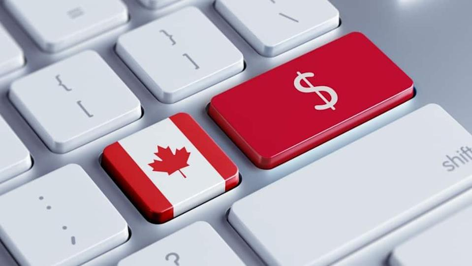 Dollar symbol and Canadian flag on keyboard