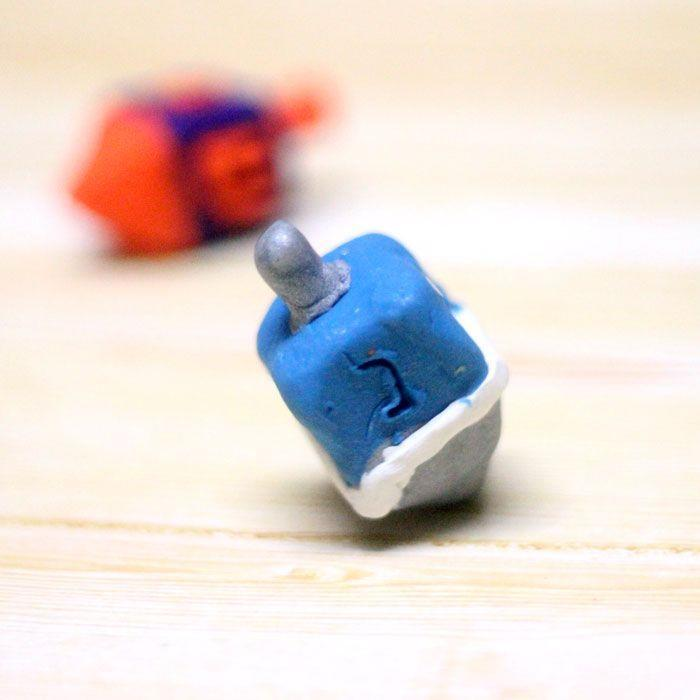 "<p>There is no more classic Hanukkah game than dreidel. Spin the top and take or give up a share of the pot (usually pennies or chocolate coins) depending on where it lands. Give it an extra personal touch with homemade dreidels you can make out of clay. </p><p><em><a href=""https://www.momsandcrafters.com/how-to-make-a-dreidel-out-of-clay/"" rel=""nofollow noopener"" target=""_blank"" data-ylk=""slk:Get the tutorial at Moms and Crafters"" class=""link rapid-noclick-resp"">Get the tutorial at Moms and Crafters</a></em><br></p><p><strong>RELATED:</strong> <a href=""https://www.goodhousekeeping.com/holidays/g34150986/hanukkah-crafts/"" rel=""nofollow noopener"" target=""_blank"" data-ylk=""slk:13 Festive Hanukkah Crafts for All Ages"" class=""link rapid-noclick-resp"">13 Festive Hanukkah Crafts for All Ages</a></p>"