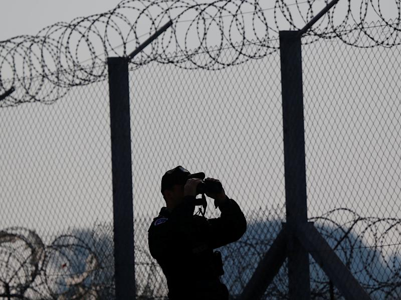 A policeman patrols the area at the Hungary and Serbia border fence near the village of Asotthalom, Hungary October 2, 2016: Reuters