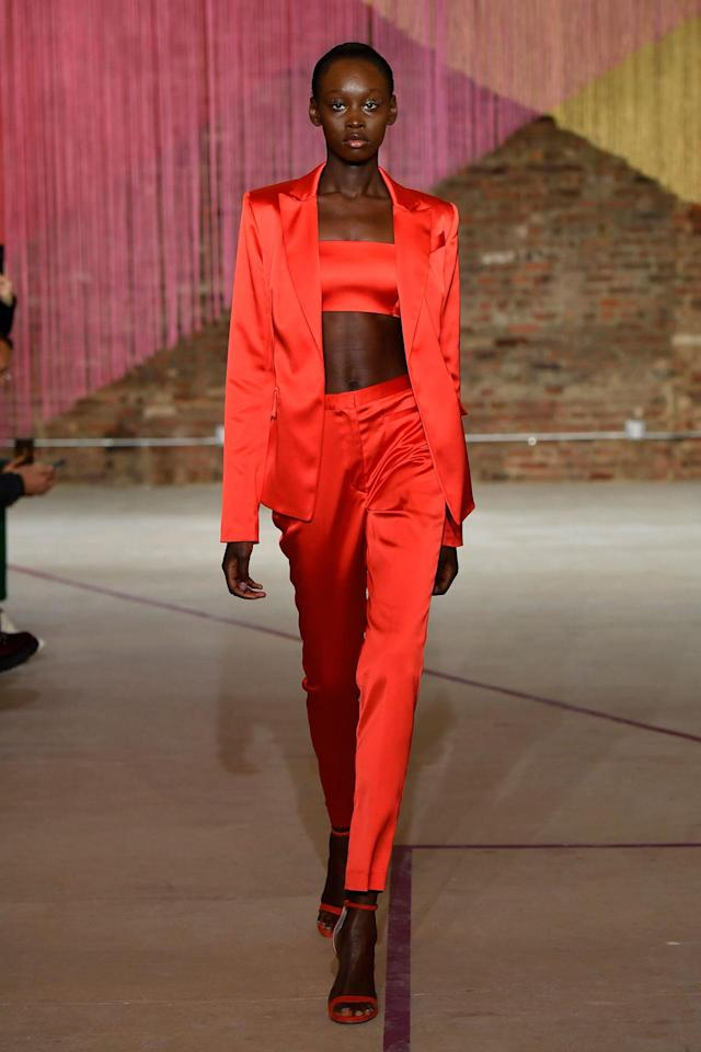 <p>Model wears a crimson red pantsuit and bandeau at the Milly Fall/Winter 2018 show. (Photo: Courtesy of Greg Kessler) </p>