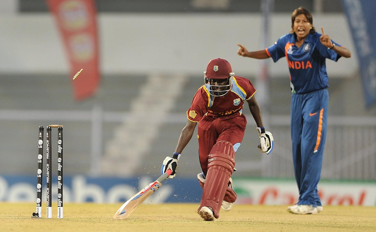 Indian cricketer Jhulan Goswami (R) looks on as Kycia Knight of West Indies is run out during the inaugural match of the ICC Women's World Cup 2013 between India and West Indies at the Cricket Club of India's Brabourne stadium in Mumbai on January 31, 2013.   AFP PHOTO/Indranil MUKHERJEE        (Photo credit should read INDRANIL MUKHERJEE/AFP/Getty Images)