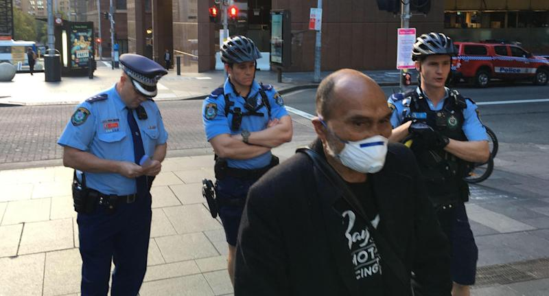 Lance Priestley of Sydney 24/7 Street Kitchen and Safe Space Community being moved on by police in Sydney's Martin Place on Friday.