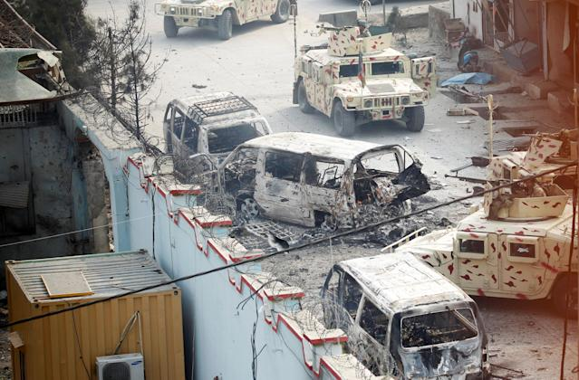 <p>Burnt vehicles are seen at the site of a blast and gun fire in Jalalabad, Afghanistan, Jan. 24, 2018. (Photo: Parwiz/Reuters) </p>