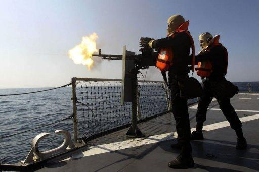 "Iranian navy officers take part in the ""Velayat-90"" naval wargames in the Strait of Hormuz in southern Iran, on January 1. Iran on Monday tested missiles near the Strait of Hormuz, underlining its threats to close the vital oil-transit waterway as the West readies to impose more economic sanctions over Tehran's nuclear drive"