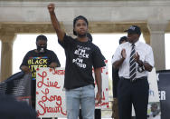 FILE - In this Sept. 4, 2020, file photo, Levar Davis, center, and community activist Steve Young , right, gesture during a Black Lives Matter rally in front of Boardwalk Hall in Atlantic City, N.J. The Black Lives Matter Global Network Foundation, which grew out of the creation of the Black Lives Matter movement, is formally expanding a $3 million financial relief fund that it quietly launched in February 2021, to help people struggling to make ends meet during the ongoing coronavirus pandemic. (AP Photo/Noah K. Murray, File)