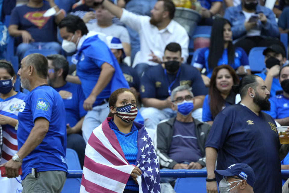 Fans wait for the start of a qualifying soccer match between El Salvador and United States for the FIFA World Cup Qatar 2022 at Cuscatlan stadium in San Salvador, El Salvador, Thursday, Sept. 2, 2021. (AP Photo/Moises Castillo)