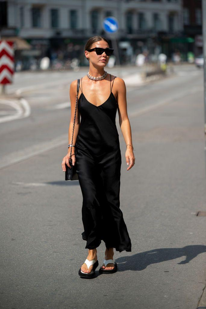 <p>A black slip dress is one of those pieces that will always come in handy. Dress it up with a pair of strappy sandals for a night out or layer a cozy knit on top and add a pair of boots for a daytime look.</p>