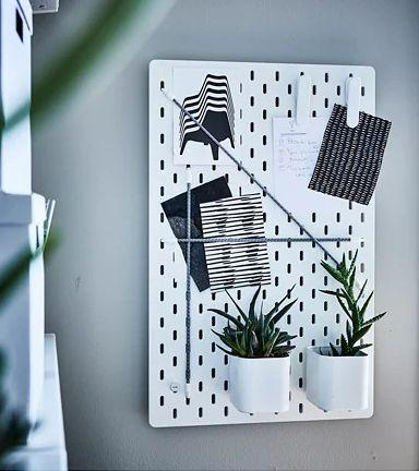 """Customize your storage for kitchen utensils, cosmetics, exercise equipment and more with this pegboard. <a href=""""https://fave.co/2YnQ6PT"""" target=""""_blank"""" rel=""""noopener noreferrer"""">Find it for $10 at IKEA.</a>"""