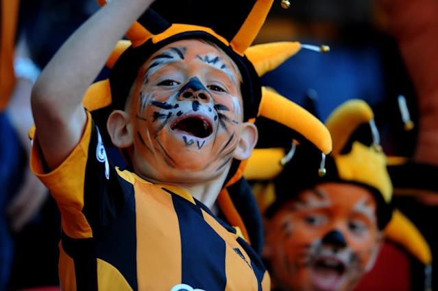 Young Hull City fans with painted faces show support for their team before the English FA Cup semifinal soccer match between Hull City and Sheffield United at Wembley Stadium, London, England, Sunday, April 13, 2014. (AP Photo/Rui Vieira)