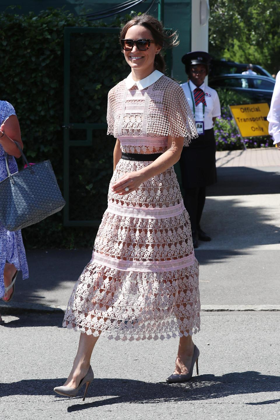 <p>Turning heads at Wimbledon, Pippa wore a blush pink, semi-sheer lace number from Self-Portrait featuring cape sleeves and a contrasting white collar.<br><em>[Photo: Getty]</em> </p>