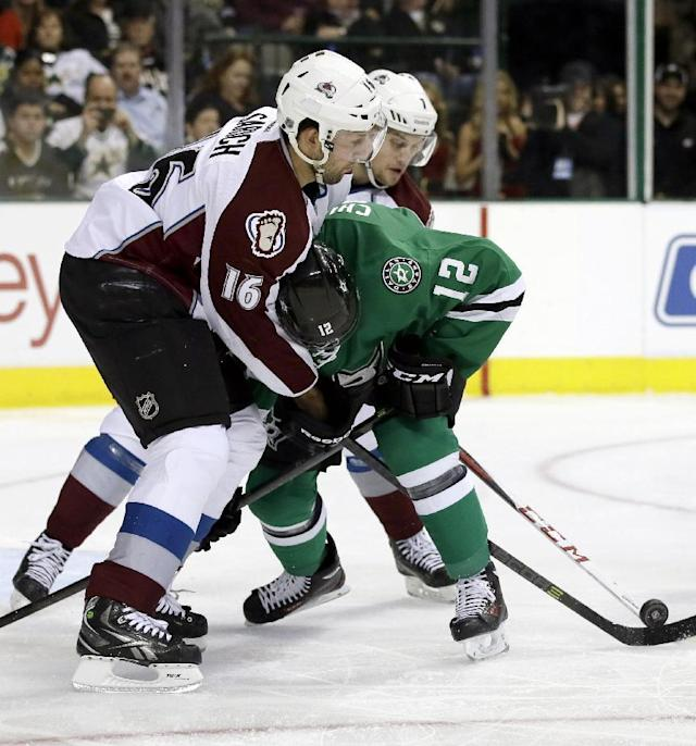 Colorado Avalanche's Cory Sarich (16) and John Mitchell defend as Dallas Stars right wing Alex Chiasson (12) loses control of the puck in front of the net in the first period of an NHL hockey game, Tuesday, Dec. 17, 2013, in Dallas. (AP Photo/Tony Gutierrez)