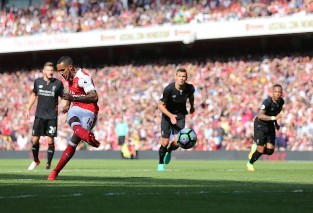 Arsenal's midfielder Theo Walcott (2ndL) takes a penalty that is saved at the Emirates Stadium in London on August 14, 2016 (AFP Photo/Lee Mills)