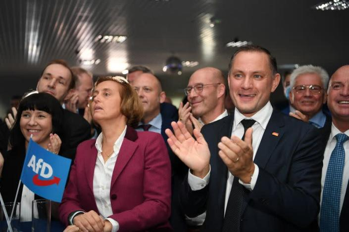 Far right AfD party politicians react after first exit polls for the German general election in Berlin