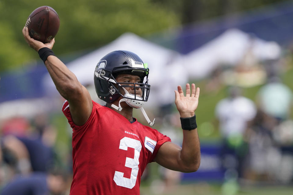 Seattle Seahawks quarterback Russell Wilson passes during NFL football practice Wednesday, July 28, 2021, in Renton, Wash. (AP Photo/Ted S. Warren)