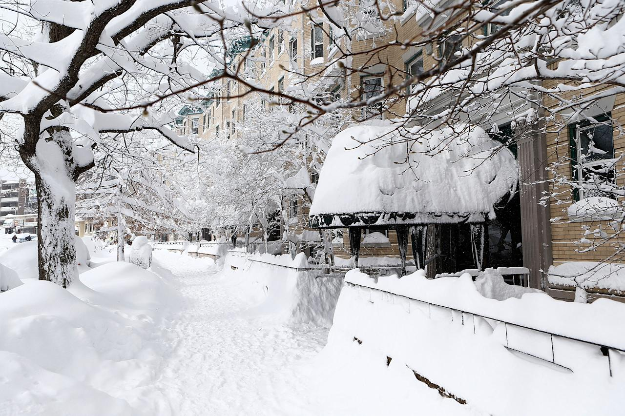 BOSTON, MA - FEBRUARY 9: A snow covered sidewalk on Commonwealth Avenue is shown on February 9, 2013 in Boston, Massachusetts. The powerful storm has knocked out power to 650,000 and dumped more than two feet of snow in parts of New England. (Photo by Jared Wickerham/Getty Images)