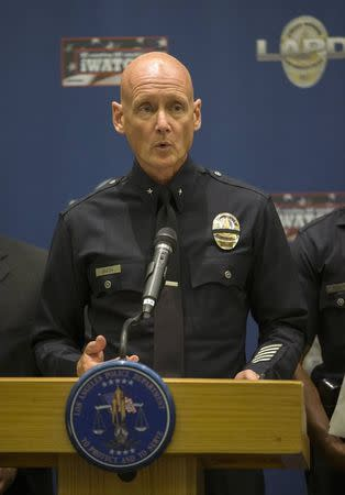 Commander Smith of the LA Police Department speaks during a news conference in Los Angeles