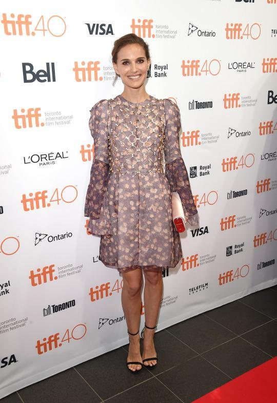 <p>Natalie Portman kicked off the 4th annual festival fundraising soiree during the 2015 Toronto International Film Festival in a Dior dress from the Fall 2015 couture collection. Not just a lilac and light pink floral mini dress, the piece features bell sleeves and a gold circular chain covering the chest.</p>