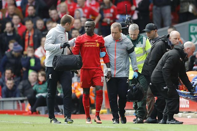 <p>Liverpool's Sadio Mane leaves the pitch after sustaining a injury </p>