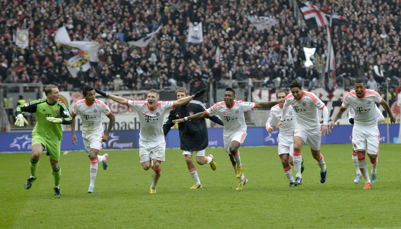 Bayern's Bastian Schweinsteiger, 3rd from left, celebrates with his team after winning the German Bundesliga championship in Frankfurt, Germany, Saturday, April 6, 2013. Bayern Munich wrapped up the German title in record time by winning 1-0 at Eintracht Frankfurt on Saturday with six rounds left in the season, an unprecedented feat in 50 years of the Bundesliga.  (AP Photo/Martin Meissner)