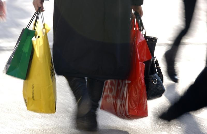 A woman carries shopping bags in Strasbourg during the first day of winter sales in France