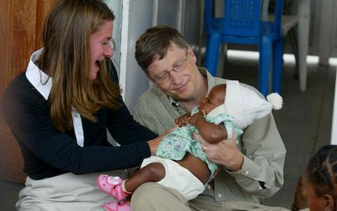 <span>Bill and Melinda Gates during a visit to Mozambique in 2003</span> <span>Credit: Reuters </span>
