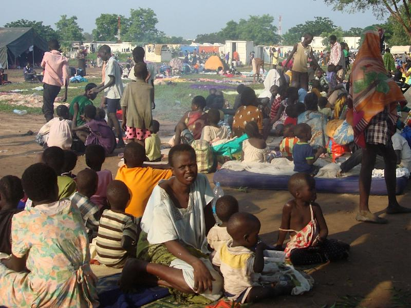 This handout image provided by the United Nation Mission in South Sudan on July 11, 2016 shows some of the at least 3000 displaced women, men and children taking shelter at the UN compound in Tomping area in Juba