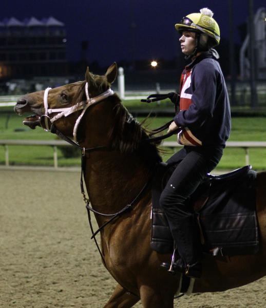 Exercise rider Laura McInerney attempts to controls Derby entry Lines of Battle during an early morning workout before the running of the 139th Kentucky Derby at Churchill Downs Saturday, May 4, 2013, in Louisville, Ky. (AP Photo/Garry Jones)