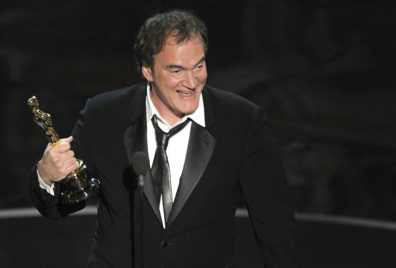 "Quentin Tarantino accepts the award for best original screenplay for ""Django Unchained"" during the Oscars at the Dolby Theatre on Sunday Feb. 24, 2013, in Los Angeles. (Photo by Chris Pizzello/Invision/AP)"
