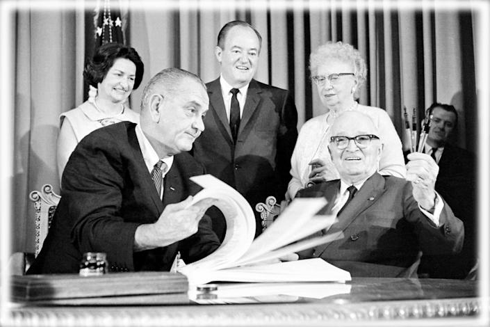 Lyndon Johnson, Harry Truman, foreground; Lady Bird Johnson, Hubert Humphrey, Bess Truman, back
