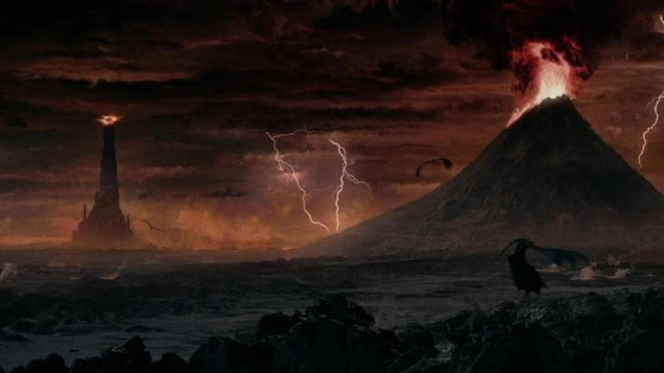The tower of Barad-dur and Mount Doom in Mordor as seen in The Lord of the Rings.