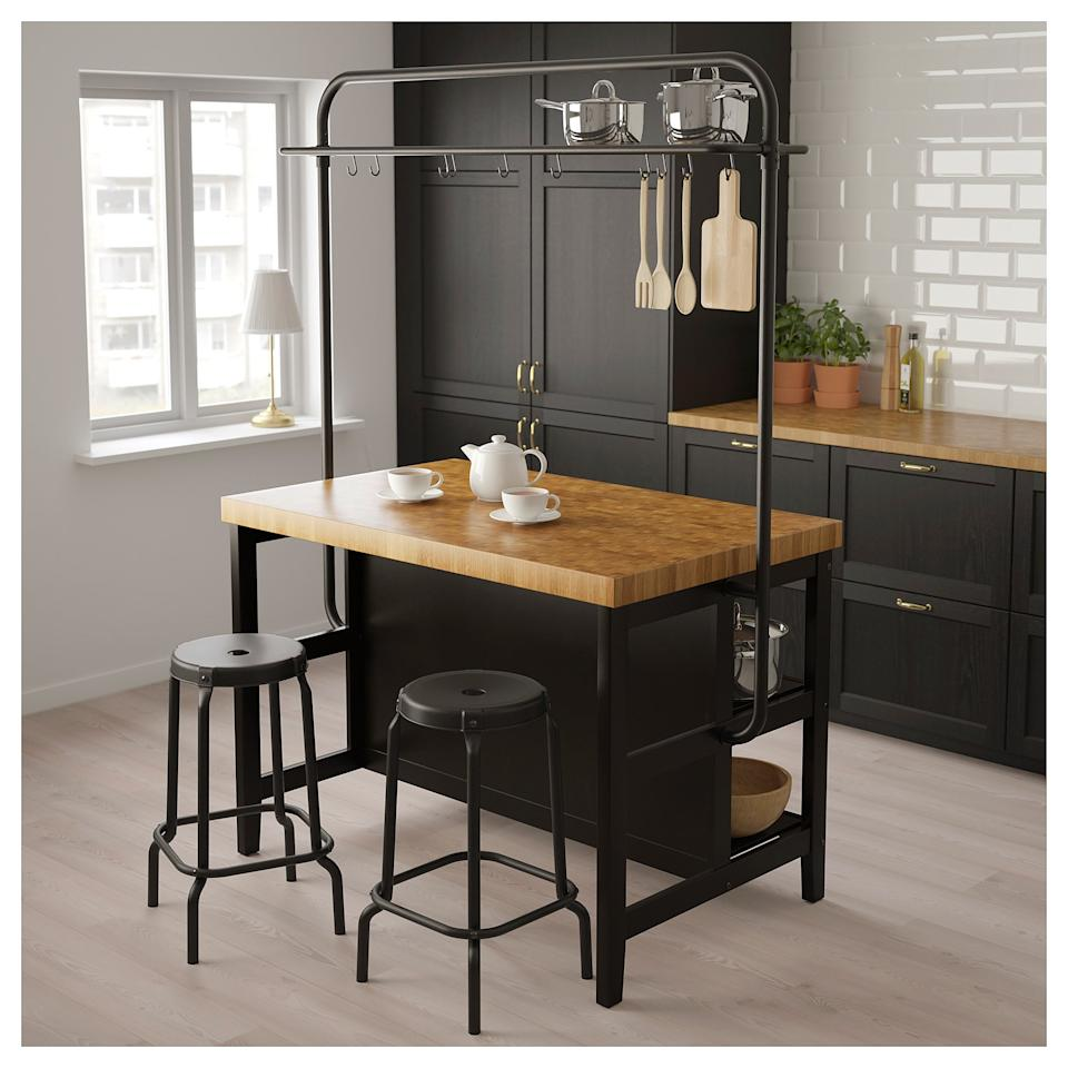 """<p>This versatile <a href=""""https://www.popsugar.com/buy/Vadholma-Kitchen-Island-Rack-447006?p_name=Vadholma%20Kitchen%20Island%20With%20Rack&retailer=ikea.com&pid=447006&price=548&evar1=casa%3Aus&evar9=46441488&evar98=https%3A%2F%2Fwww.popsugar.com%2Fphoto-gallery%2F46441488%2Fimage%2F46441790%2FVadholma-Kitchen-Island-Rack&list1=shopping%2Cfurniture%2Cikea%2Ckitchens&prop13=api&pdata=1"""" rel=""""nofollow"""" data-shoppable-link=""""1"""" target=""""_blank"""" class=""""ga-track"""" data-ga-category=""""Related"""" data-ga-label=""""https://www.ikea.com/us/en/catalog/products/S59276228/"""" data-ga-action=""""In-Line Links"""">Vadholma Kitchen Island With Rack</a> ($548) has shelves for pots and pans, hanging storage for every cooking gadget in the books, and a robust butcher block for prepping meals.</p>"""