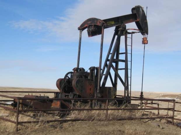 An abandoned oil well awaiting removal. Critics say the number of orphaned and abandoned wells is growing faster than resources to clean them up.