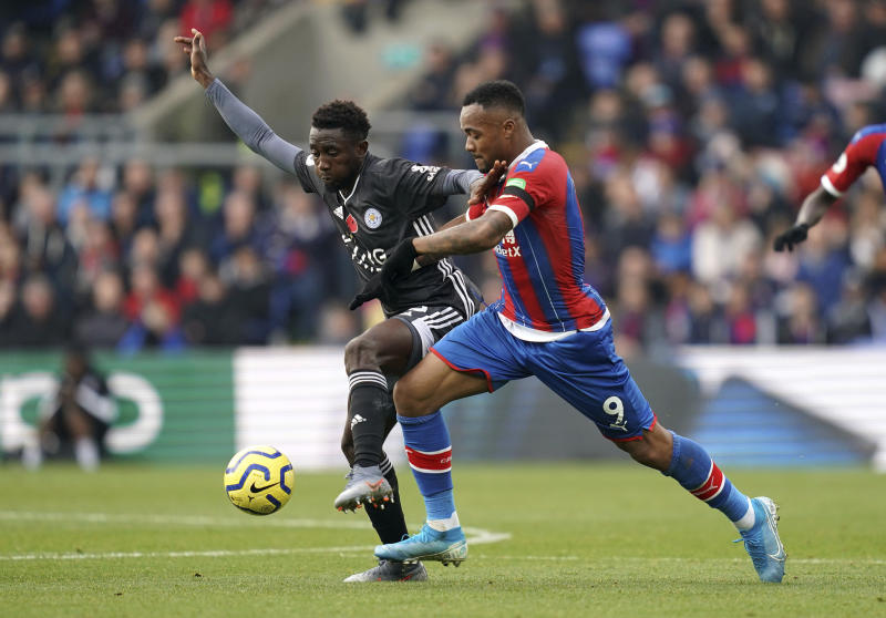 Leicester City's Wilfred Ndidi, left, and Crystal Palace's Jordan Ayew battle for the ball during the English Premier League soccer match at Selhurst Park, London, Sunday Nov. 3, 2019. (John Walton/PA via AP)