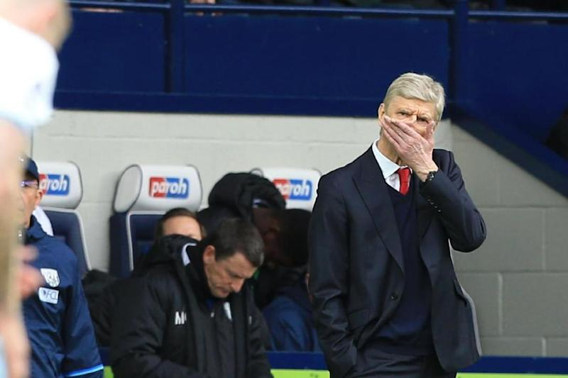 Caught in a storm: Wenger as Arsenal lose at The Hawthorns Photo: Lindsey Parnaby/AFP/Getty Images