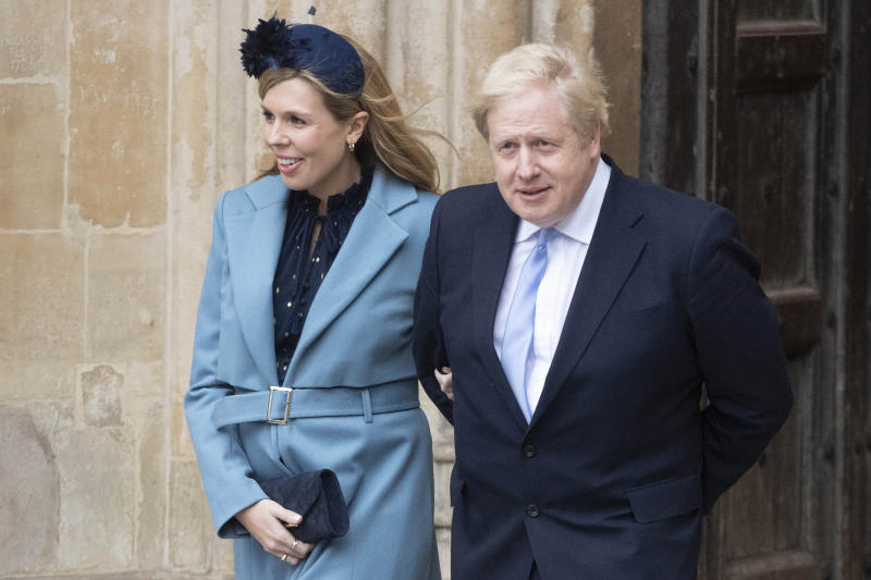 LONDON, March 10, 2020 -- British Prime Minister Boris Johnson R and his partner Carrie Symonds leave the Westminster Abbey after attending the annual Commonwealth Service on Commonwealth Day in London, Britain, March 9, 2020. (Photo by Ray Tang/Xinhua via Getty) (Xinhua/Han Yan via Getty Images)