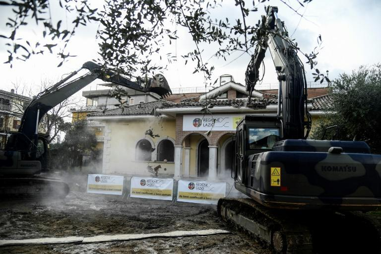 Rome's mayor ordered eight illegal and typically ornate Casamonica villas bulldozed in 2018 (AFP/Filippo MONTEFORTE)