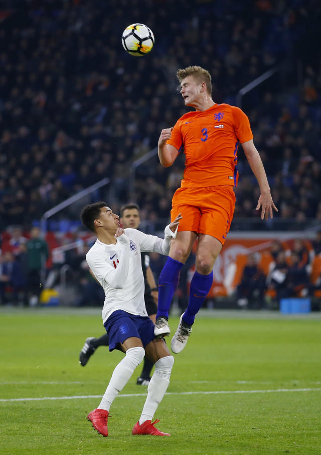 Matthijs de Ligt of the Netherlands competes for the ball with England's Jesse Lingard, left, during the international friendly soccer match between the Netherlands and England at the Amsterdam ArenA in Amsterdam, Netherlands, Friday, March 23, 2018. (AP Photo/Peter Dejong)
