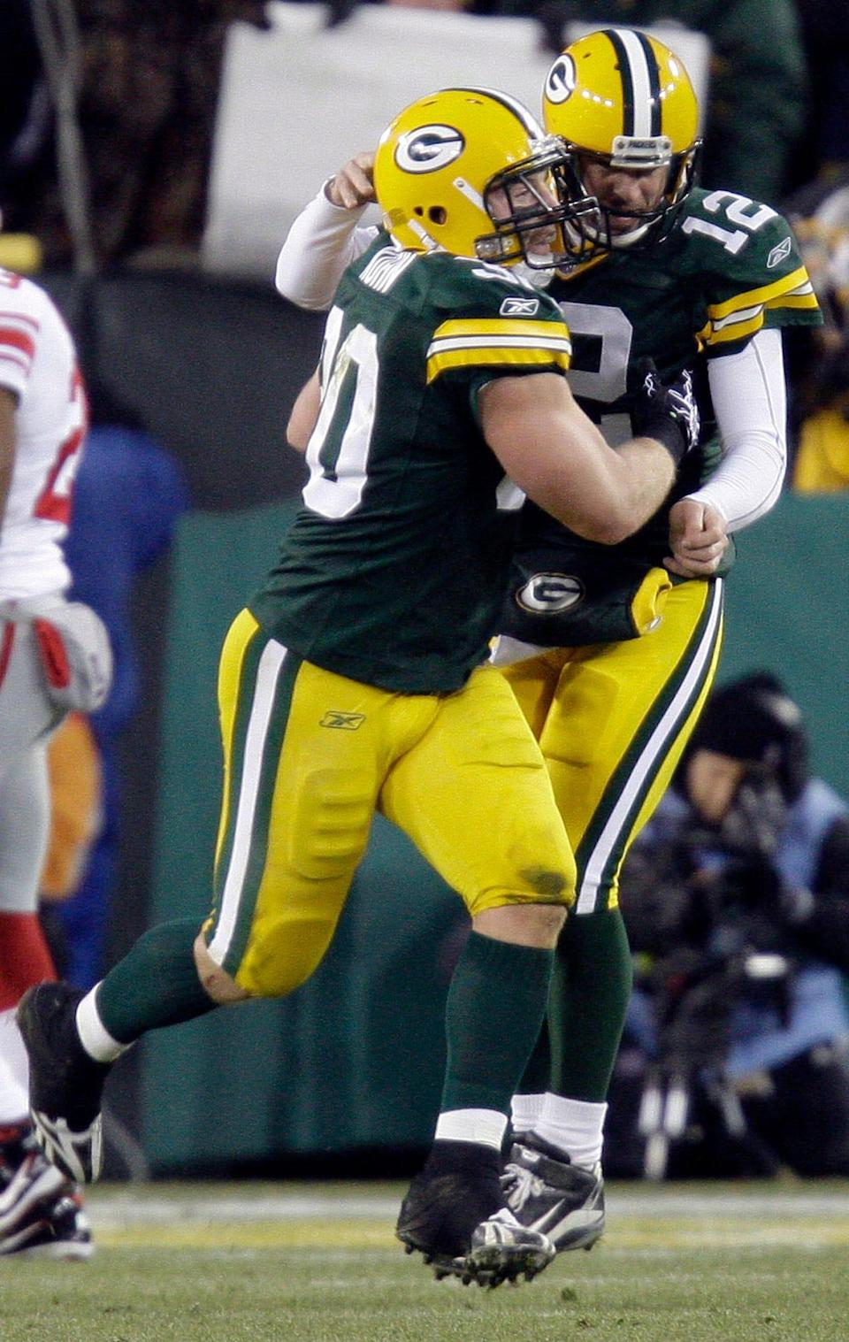 Green Bay Packers fullback John Kuhn (30) is congratulated by quarterback Aaron Rodgers after an 8 yard touchdown run during the second quarter of their game against the New York Giants Sunday, December 26, 2010 at Lambeau Field in Green Bay, Wis.