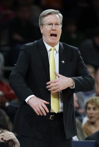 Iowa head coach Fran McCaffery calls out to his team during the first half of an NIT semifinal basketball game against Maryland Tuesday, April 2, 2013, in New York. (AP Photo/Frank Franklin)