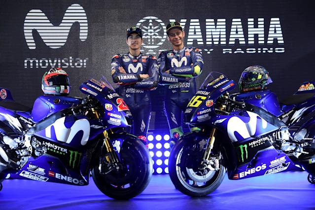 Sport Motorcycling - Movistar Yamaha Team Presentation - Madrid, Spain - January 24, 2018 Movistar Yamaha's MotoGP riders Maverick Vinales of Spain and Valentino Rossi of Italy pose with their new bikes for the 2018 racing season. REUTERS/Susana Vera