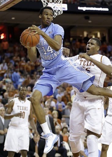 North Carolina's Desmond Hubert (14) grabs a rebound in front of Texas' Cameron Ridley, right, during the first half of an NCAA college basketball game, Wednesday, Dec. 19, 2012, in Austin, Texas. (AP Photo/Eric Gay)