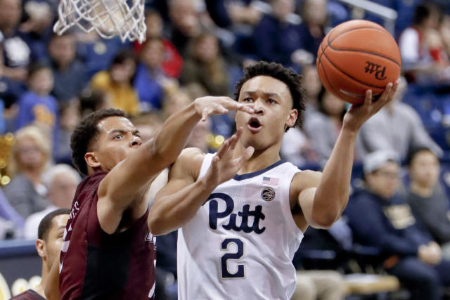 Pittsburgh's Trey McGowens (2) shoots around Maryland Eastern Shore's Tyler Jones during the first half of an NCAA college basketball game, Saturday, Dec. 15, 2018, in Pittsburgh. (AP Photo/Keith Srakocic)
