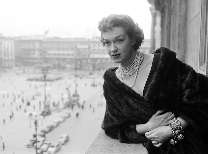 FILE - This March 24, 1954 file photo shows soprano Rise Stevens posing on a balcony in Milan, Italy. Stevens, who sang with the Metropolitan Opera for more than 20 years spanning the 1940s and 1950s, died Wednesday, March 20, 2013 at her Manhattan home. She was 99. (AP Photo/Raul Fornezza, file)