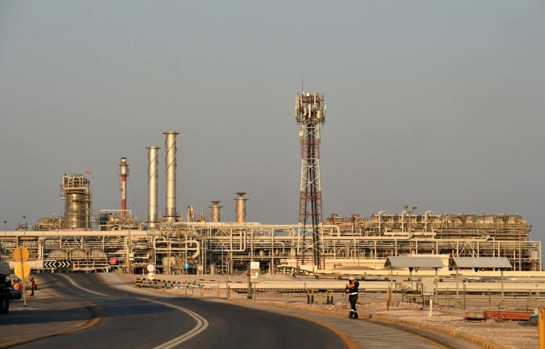 Saudi Aramco (Abqaiq processing plant pictured September 2019) will push back its IPO, a move that could delay the oil giant's stock market trading by a few months