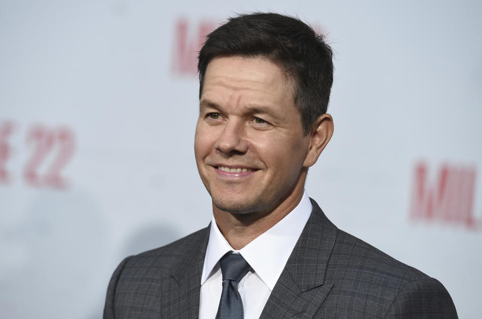 """Mark Wahlberg arrives at the Los Angeles premiere of """"Mile 22"""" on Thursday, Aug. 9, 2018 in Los Angeles. (Photo by Jordan Strauss/Invision/AP)"""